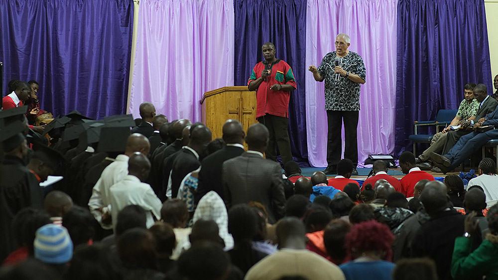 Pastor Scibelli addressing graduates