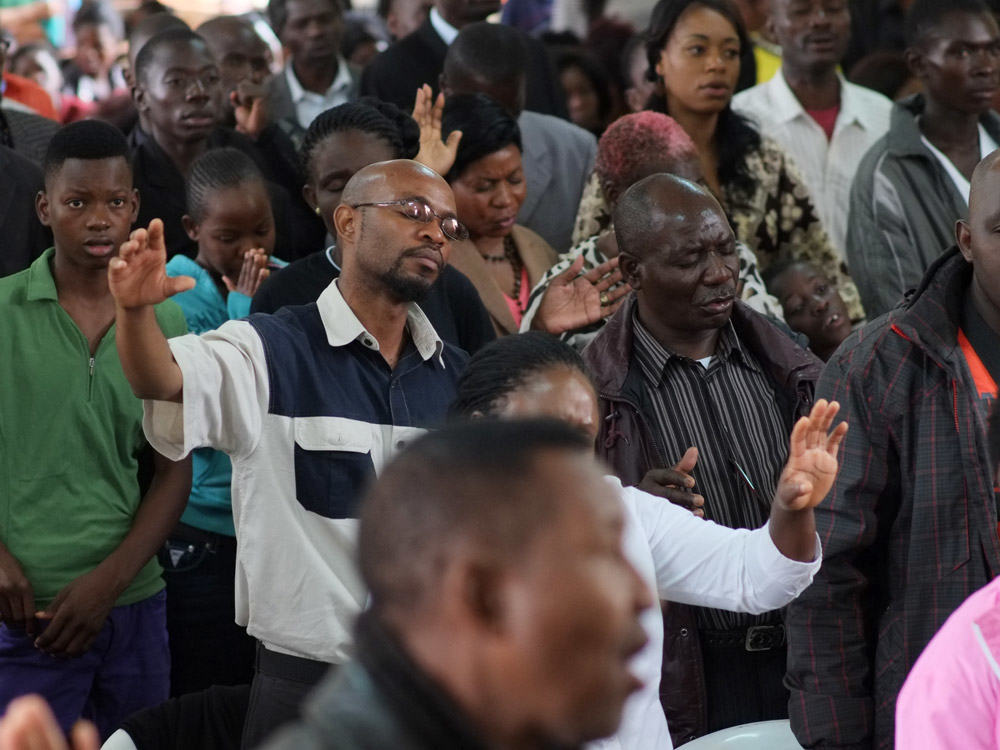 young man praising God